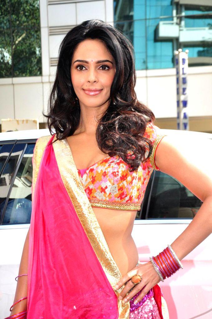 Actress Mallika Sherawat during music launch of film Dirty Politics in Mumbai. - Mallika Sherawat