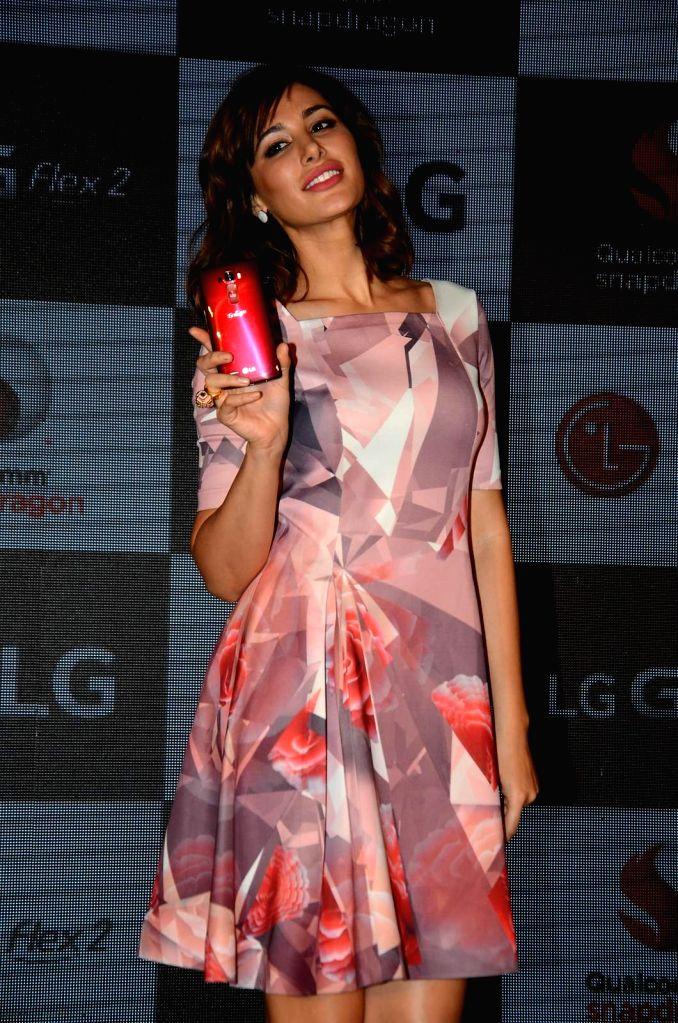 Actress Nargis Fakhri during the launch of LG G Flex2 phones, in Mumbai, on April 30, 2015. - Nargis Fakhri