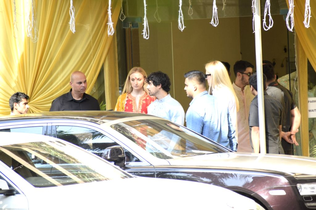 Mumbai: Actress Priyanka Chopra's fiancé and American singer Nick Jonas' brother Joe Jonas and his fiance Sophie Turner at a puja ceremony at the actress' mother Madhu Chopra's residence in Mumbai, on Nov 28, 2018. (Photo: IANS) - Priyanka Chopra and Madhu Chopra