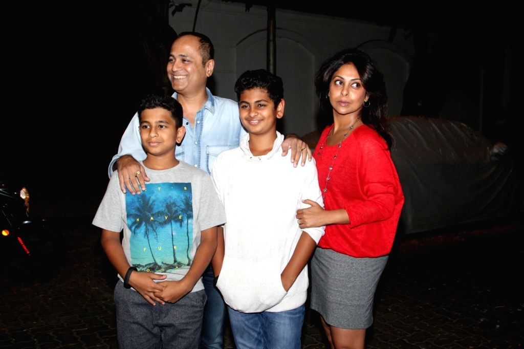Actress Shefali Shah, her husband and filmmaker Vipul Shah and sons arrive for actor Anil Kapoor`s get-together to share the trailer of the film Dil Dhadakne Do, in Mumbai on 13th April 2015. - Shefali Shah and Vipul Shah