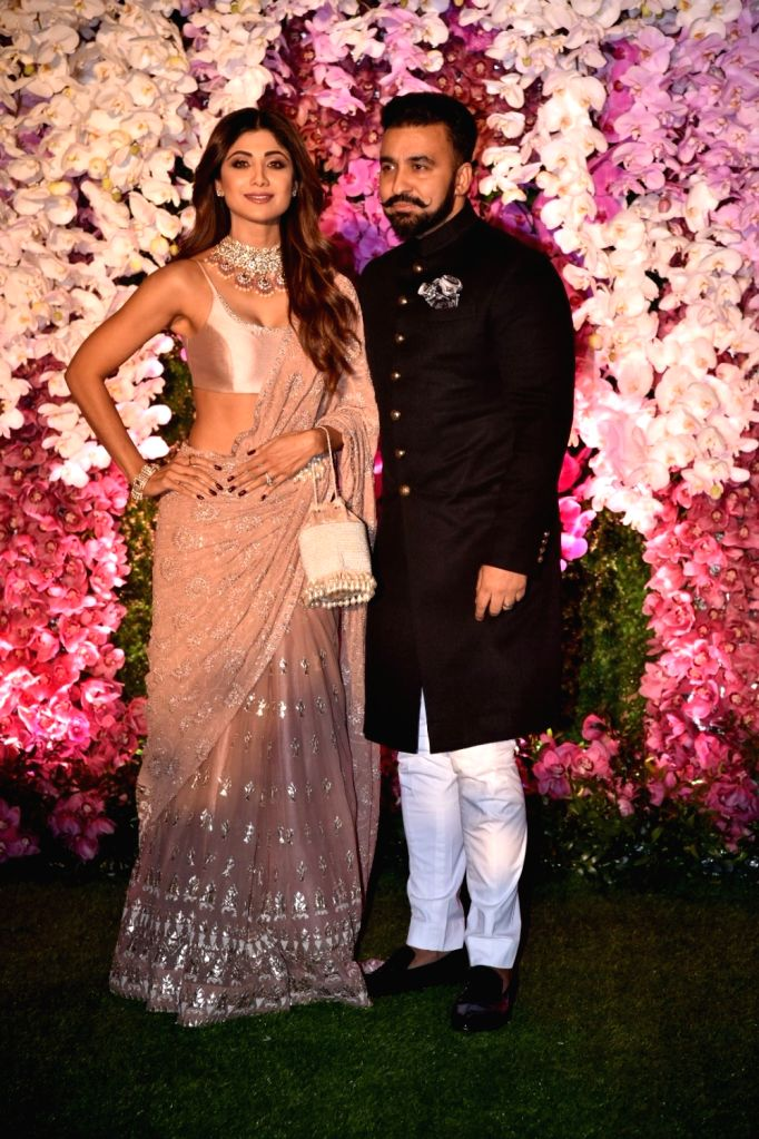 Mumbai: Actress Shilpa Shetty Kundra along with her husband Raj Kundra at the wedding reception of Akash Ambani and Shloka Mehta in Mumbai on March 10, 2019. (Photo: IANS) - Shilpa Shetty Kundra, Raj Kundra, Akash Ambani and Shloka Mehta