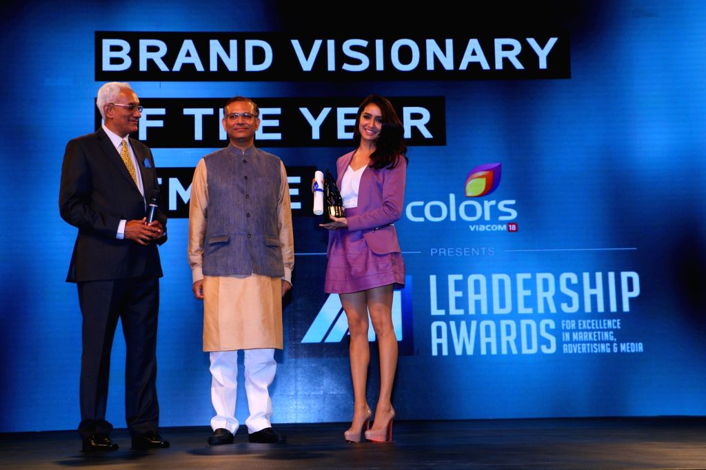 Actress Shraddha Kapoor receives the Visionary of the Year (female) award at the International Advertising Association Awards ceremony hosted by Colours, in Mumbai on April 19, 2015.