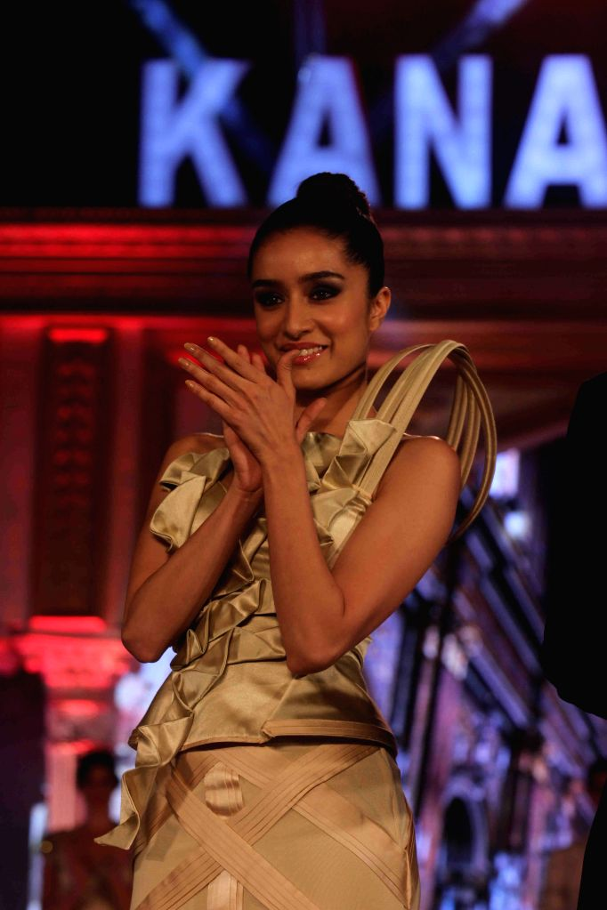 Actress Shraddha Kapoor walks the ramp as showstopper flaunting an outfit by designer Ken Ferns, at a fashion show held by Kanakia Paris, in Mumbai on April 9, 2015.