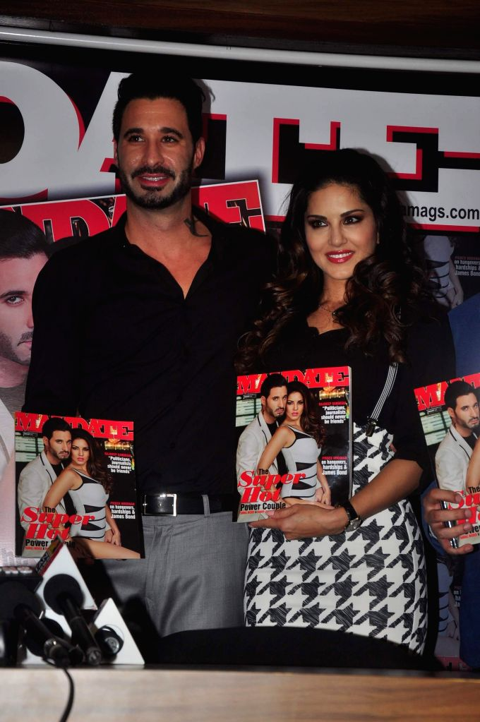 Actress Sunny Leone along with her husband Daniel Weber during the cover launch of Mandate magazine's January issue in Mumbai on Jan 16, 2015. - Sunny Leone