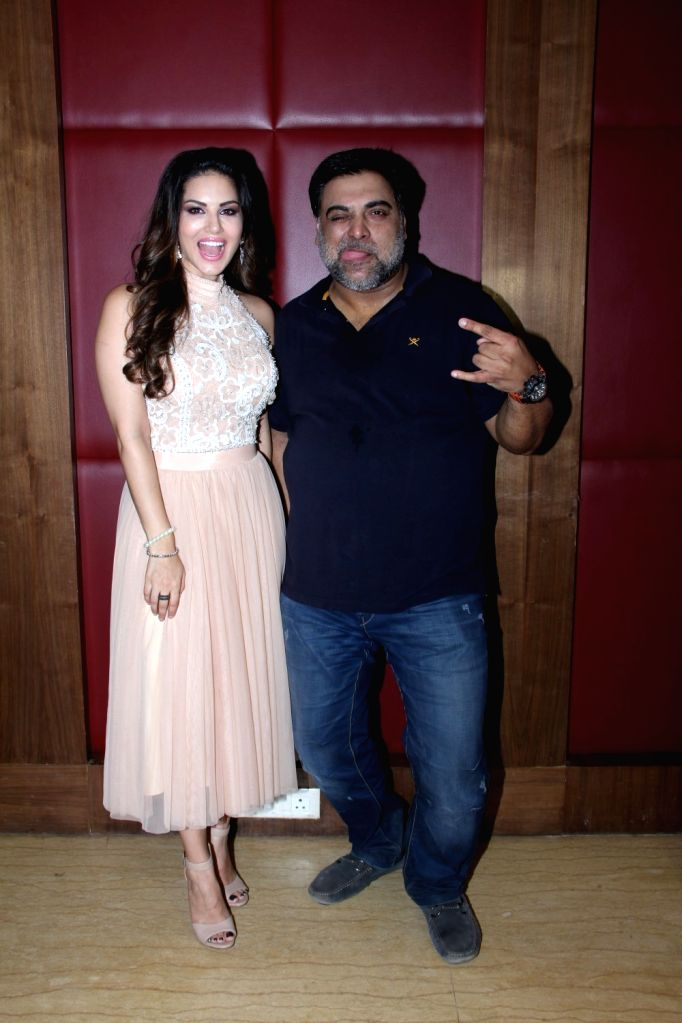Actress Sunny Leone and actor Ram Kapoor during a media interaction at the promotion of film Kuch Kuch Locha Hai in Mumbai. - Sunny Leone and Kapoor