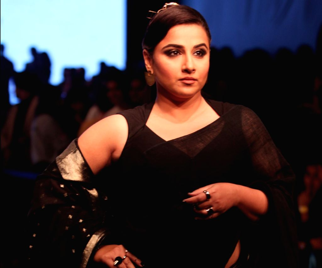 Mumbai: Actress Vidya Balan showcases fashion designer Anavila Misra's creation during Lakme Fashion Week (LFW) Summer/Resort 2019 in Mumbai, on Feb 1, 2019. (Photo: IANS) - Vidya Balan