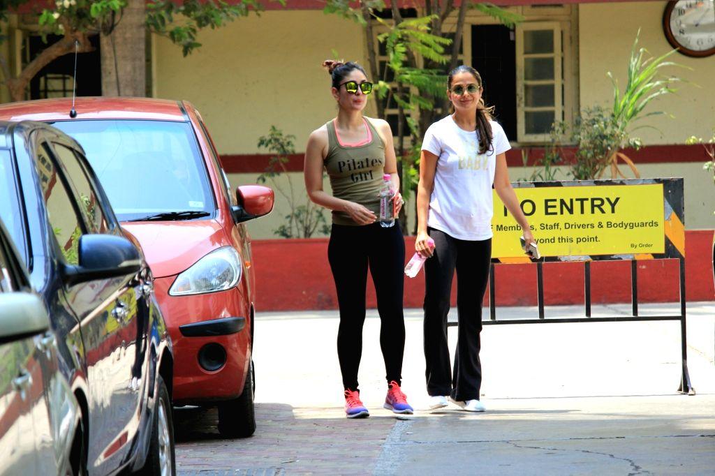 Mumbai: Actresses Kareena Kapoor Khan and Amrita Arora seen at a gym in Mumbai on April 4, 2018. (Photo: IANS) - Kareena Kapoor Khan and Amrita Arora