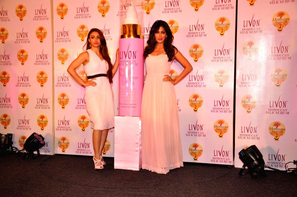 Actressess Soha Ali Khan and Chitrangada Singh during the launch of Livon Moroccan Silk Serum in Mumbai on Dec 2, 2014.