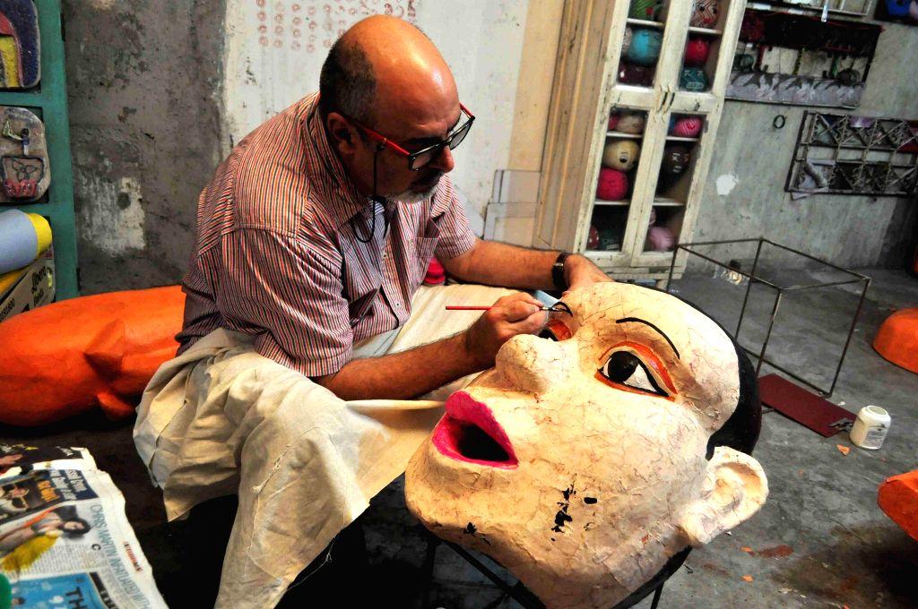 An artist participates in Alley Galli Biennale in Mumbai, on Feb 12, 2015.