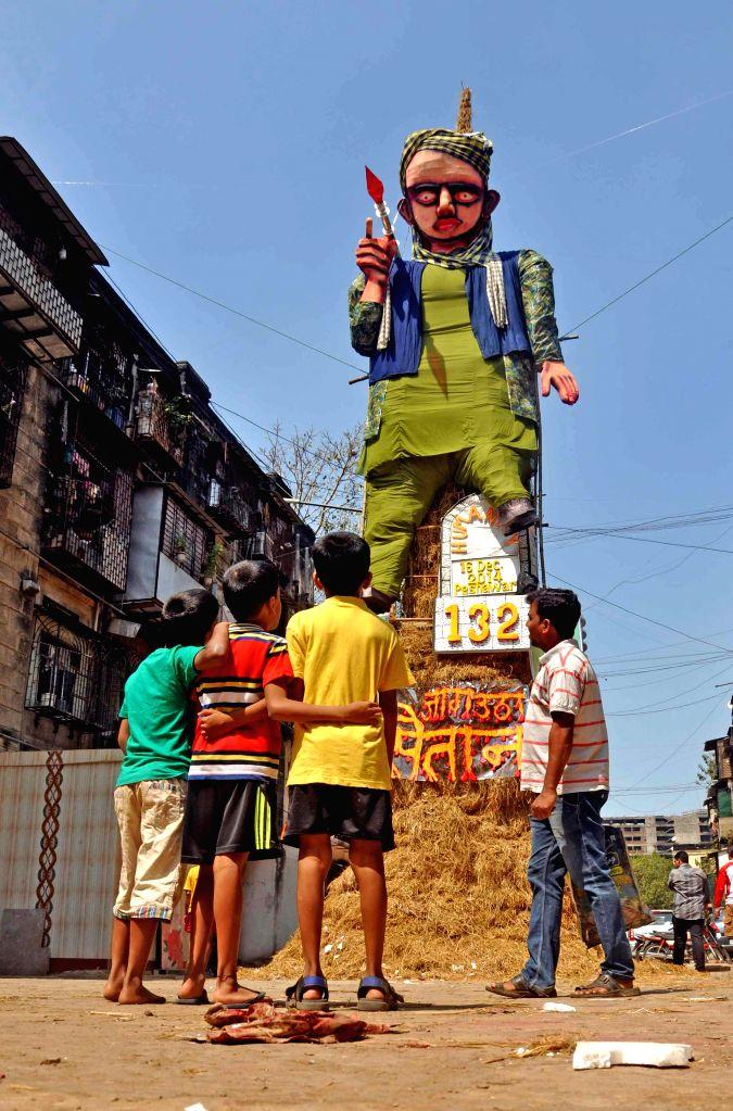 An effigy symbolising the terrorists who attacked a Peshawar school ready for `Holika Dahan` at BDD Chawl in Mumbai, on March 4, 2015.