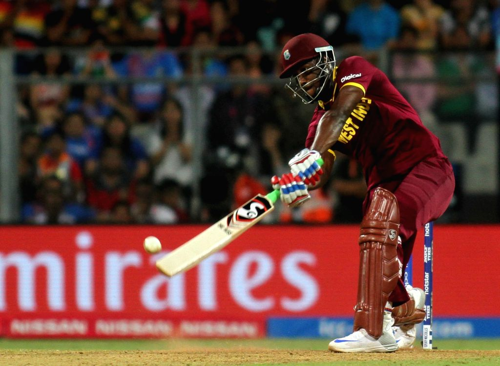 Mumbai: Andre Russell of West Indies in action during the second WT20 semi-final match between India and West Indies at Wankhede Stadium in Mumbai, on March 31, 2016. (Photo: Nitin Lawate/IANS)