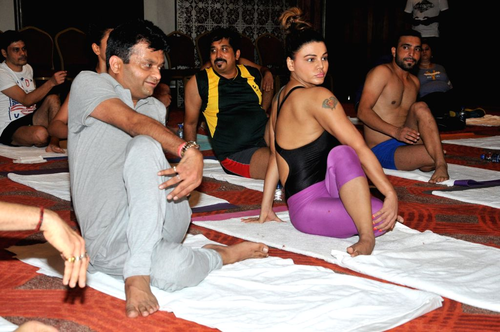 Aneel Murarka and Rakhi Sawant perform Yoga on International Yoga Day in Mumbai on Sunday, June 21st, 2015.