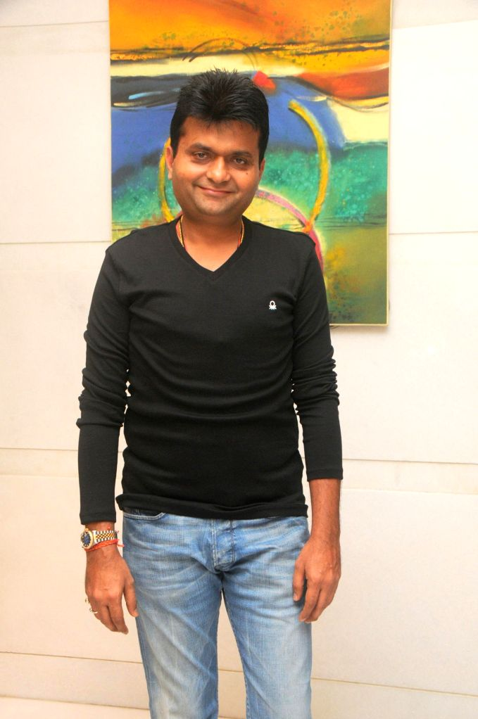 Aneel Murarka during the photo exhibition `The Melted Core` by photographer Nisheeth Bhatt in Mumbai, on Nov. 4, 2014.