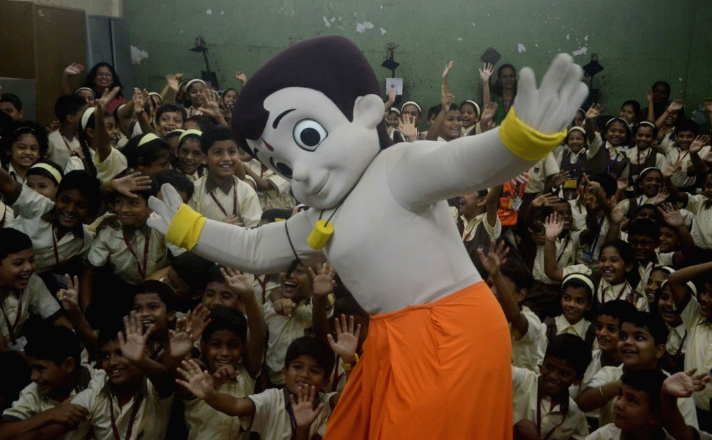 Mumbai: Animated character Chhota Bheem with students and teachers during a programme organised on the occasion of Guru Purnima in Mumbai on July 19, 2016. (Photo: IANS)