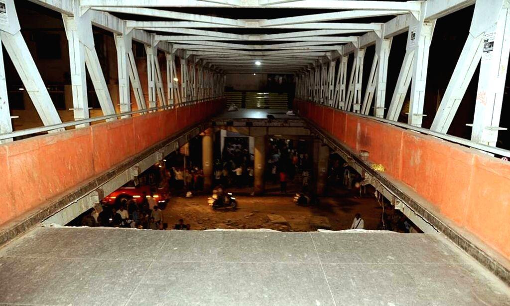 Mumbai: At least 12 commuters were injured when a portion of a pedestrian bridge crashed near the Chhatrapati Shivaji Terminus in Mumbai on March 14, 2019. (Photo: IANS)