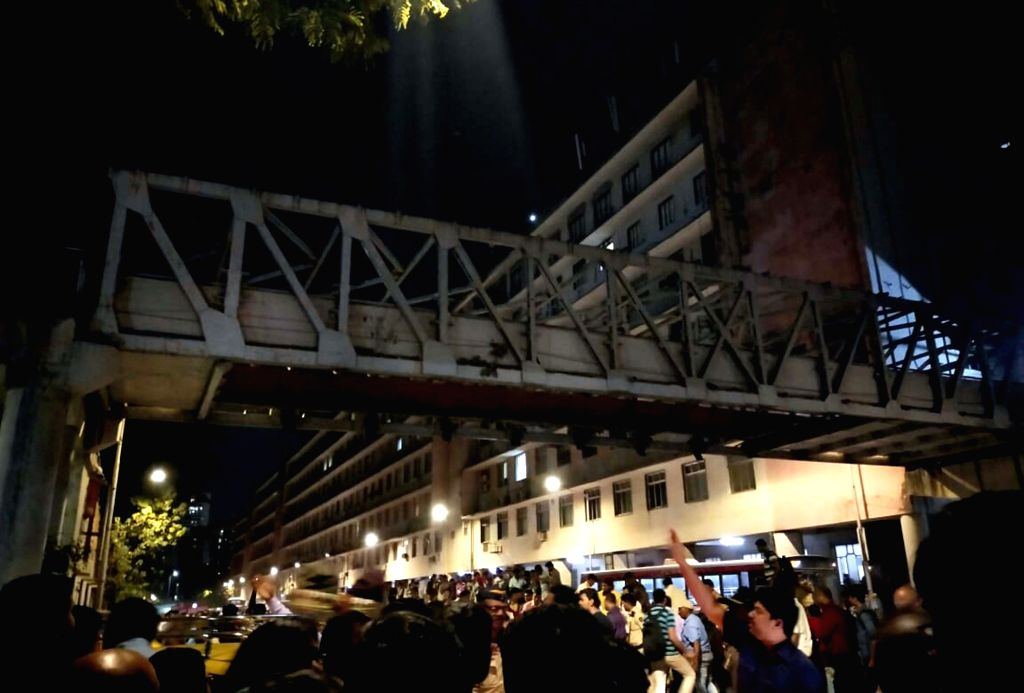 Mumbai: At least 12 commuters were injured when a portion of a pedestrian bridge crashed near the Chhatrapati Shivaji Terminus in Mumbai on March 14, 2019. (Photo: IANS)