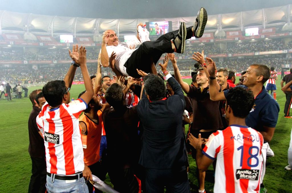 Atletico de Kolkata players celebrates after defeating Kerala Blasters FC to clinch the first ISL trophy at at D.Y Patil Stadium, in Mumbai on Dec 20, 2014. - Y Patil Stadium