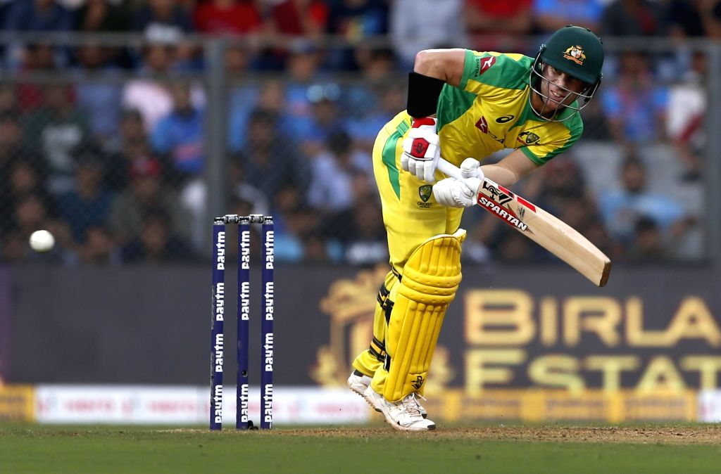 Mumbai: Australia's David Warner in action during the first ODI between India and Australia at the Wankhede Stadium in Mumbai on Jan 14, 2020. (Photo: Surjeet Yadav/IANS) - Surjeet Yadav