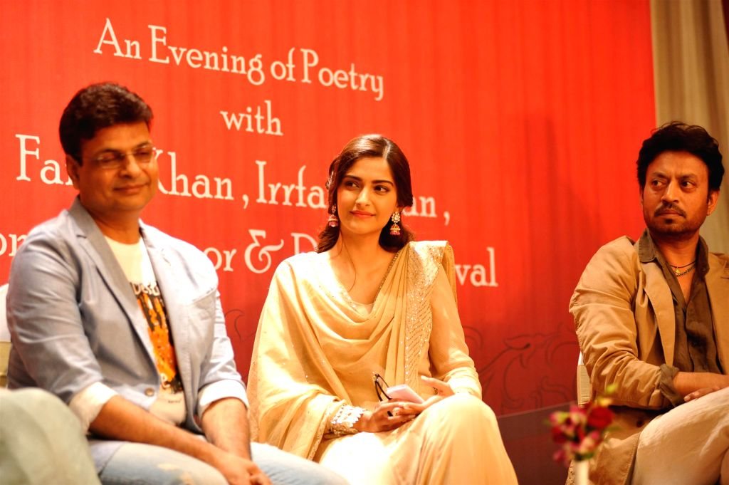 Author Irshad Kamil, actors Sonam Kapoor, Irrfan Khan during the launch of Irshad Kamil`s book Ek Maheena Nazmon Ka , in Mumbai on Jan. 3, 2015. - Sonam Kapoor and Irrfan Khan
