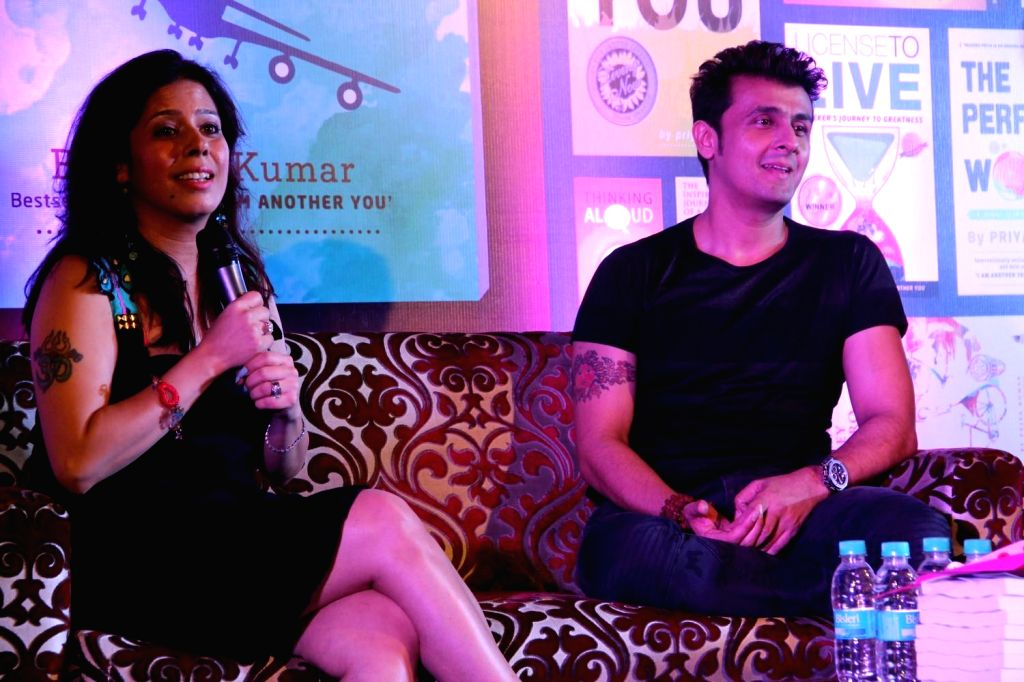 Author Priya Kumar with singer Sonu Nigam during the launch of author Priya Kumar's book I Will Go With You - The Flight of a Lifetime in Mumbai on 18th Feb, 2015.