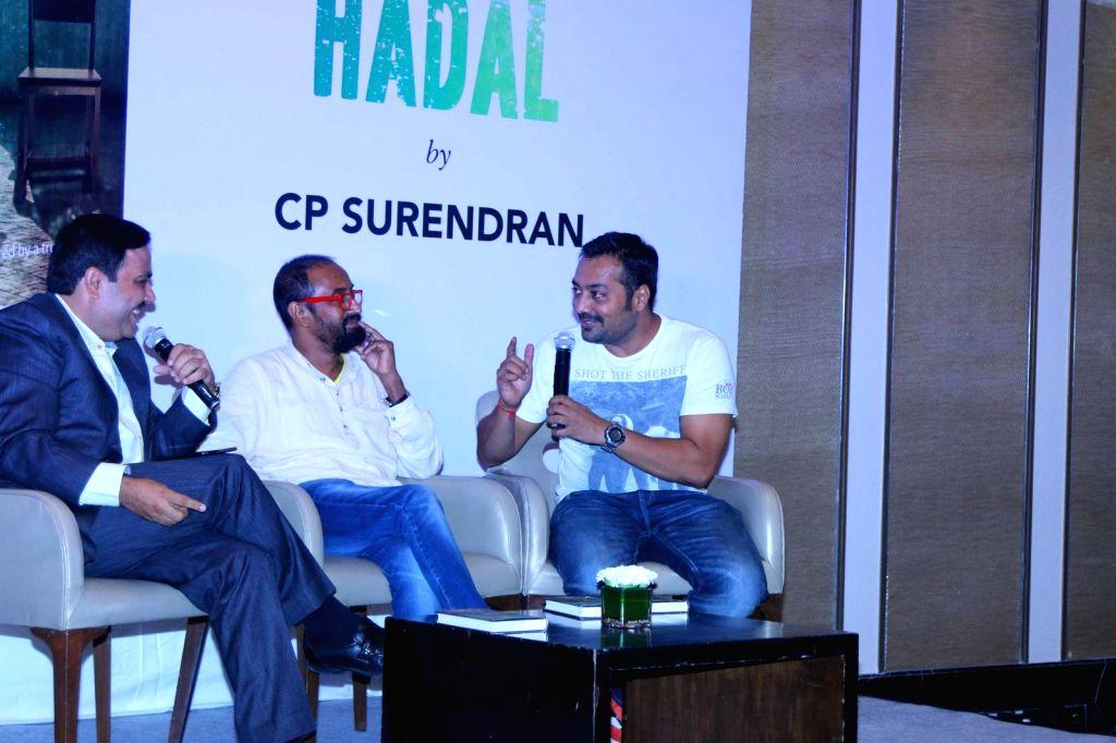 Author Ravi Subramanian, Senior journalist C P Surendran and filmmaker Anurag Kashyap during the launch of senior journalist C P Surendran`s book `Hadal`, in Mumbai on April 10, 2015. - Anurag Kashyap