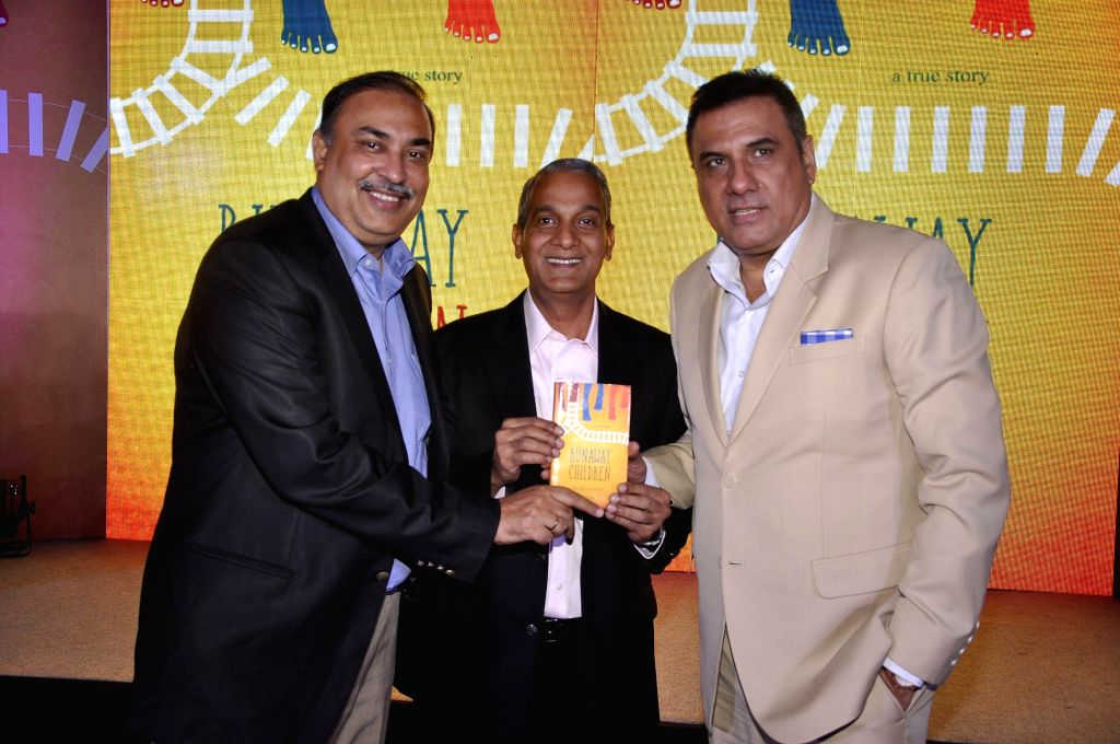 Author S Hariharan with Sunil Sood, Chief Operating Officer, Vodafone India, and actor Boman Irani during the launch of book Run Away Children by author S Hariharan in Mumbai on Jan 16, 2015. - Boman Irani