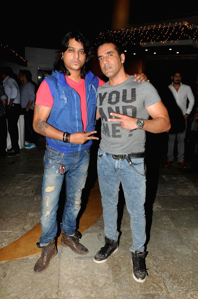 Aziz Ze with Friend during the launch of film Melody in Mumbai, on November 20, 2014.