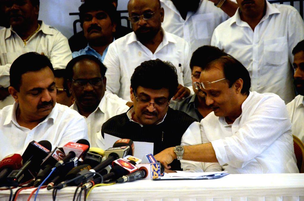 Mumbai: Bahujan Vikas Aaghadi President Hitendra Thakur, Congress leader Ashok Chavan and NCP leader Ajit Pawar during a joint press conferenceof Congress-led Maha-Aghadi (grand alliance) parties in Mumbai, on March 23, 2019. (Photo: IANS)
