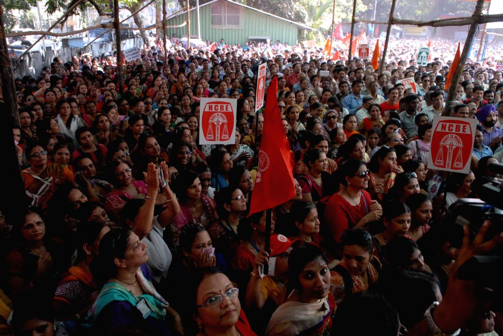 Bank Employees demonstrate in front of a bank during a day-long strike called to press for their demands, including pay revision in Mumbai, on Nov 12, 2014. Employees of 27 public sector ...