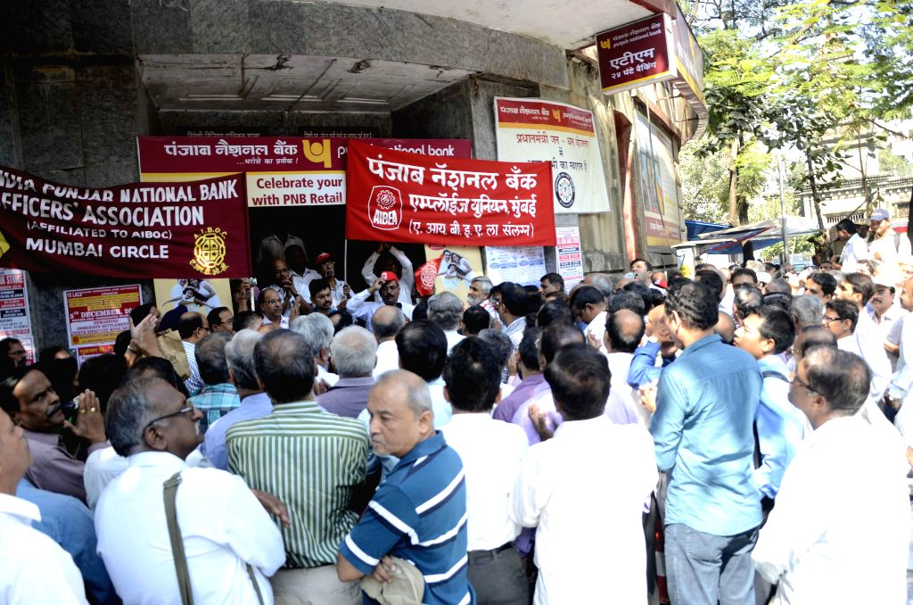 Bank employees stage a demonstration  to press for their demands in Mumbai, on Dec 5, 2014.