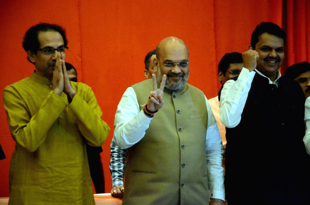 Mumbai: BJP President Amit Shah and Sena President Uddhav Thackeray, along with Maharashtra Chief Minister and BJP leader Devendra Fadnavis during a joint media briefing regarding BJP-Shiv Sena alliance for upcoming Lok Sabha and Maharashtra Assembly - Amit Shah