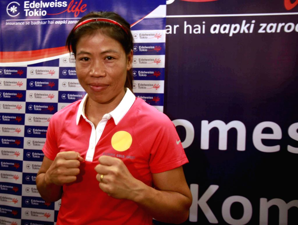 Boxer MC Mary Kom during an event organised by Edelweiss Tokio life insurance in Mumbai on Nov. 20, 2014. The company handed over a cheque drawn out of the crowd funding initiative to support