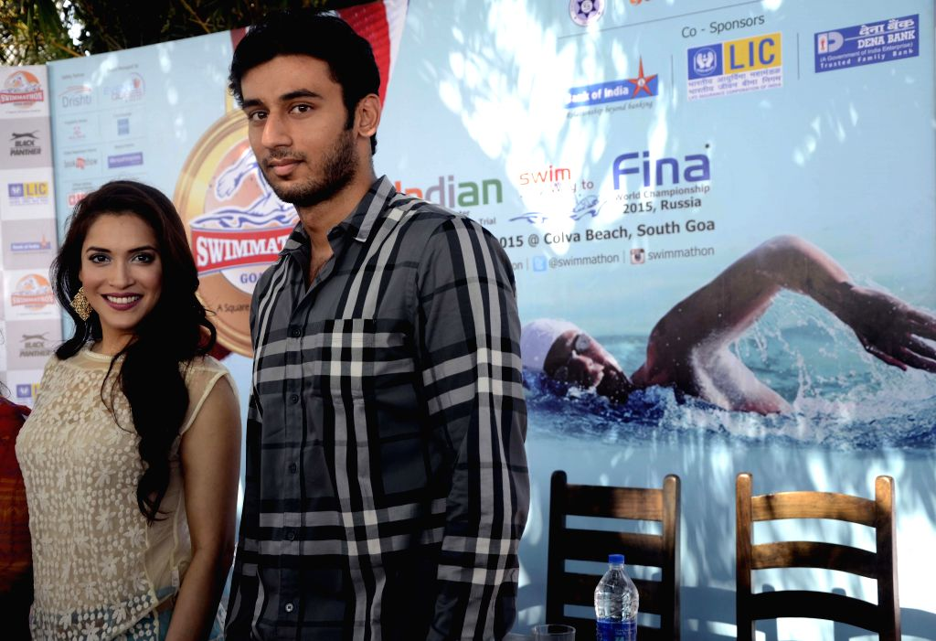 Brand Ambassador of Swimathon 2015 swimmer Virdhawal Khade with actress Rashmi Nigam during a programme organised to promote Swimathon 2015 scheduled to be held in Goa on 22nd February 2015; .
