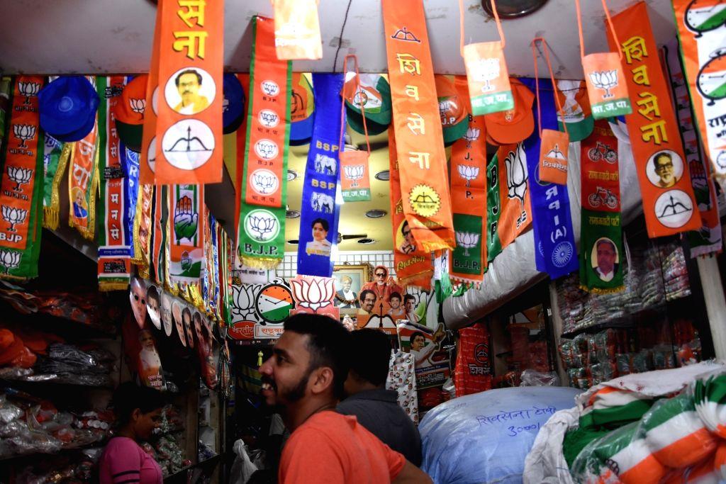 Mumbai: Campaign materials being sold at a shop ahead of Maharashtra Assembly polls in Mumbai on Oct 2, 2019. (Photo: IANS)