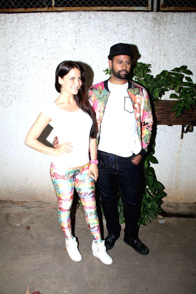 Caption : Mumbai: Caption : Mumbai: Actress Elli Avram and VJ Andy during the special screening of film Ek Paheli Leela in Mumbai on April 9, 2015. - Elli Avram