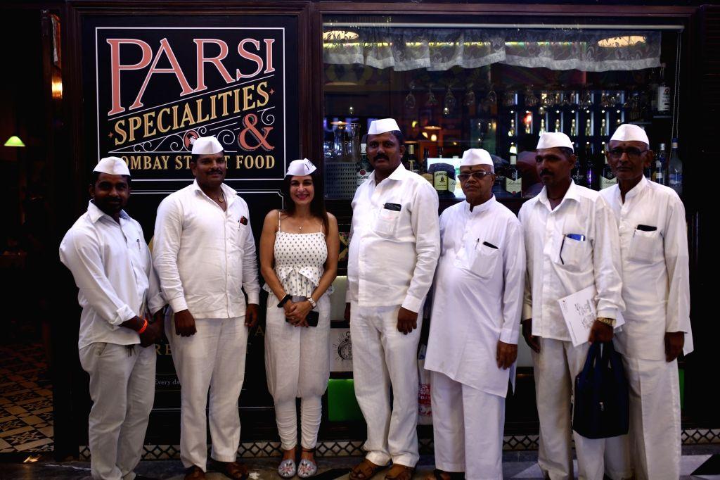 Mumbai: Chef Anaida Parvaneh with fellow Dabbawalas outside restaurant chain SodaBottleOpenerWalaa's Phoenix outlet.