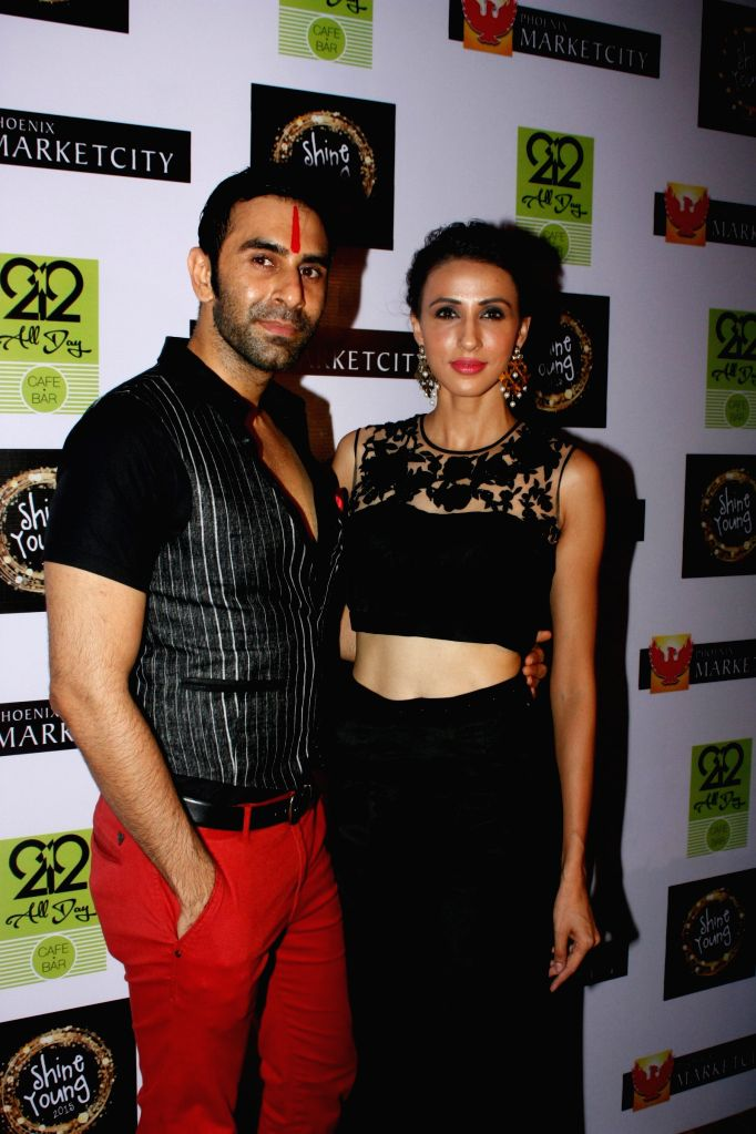 Choreographer Sandip Soparrkar and model Alesia Raut during the grand finale of Shine Young 2015 in Mumbai, on June 21, 2015. - Alesia Raut