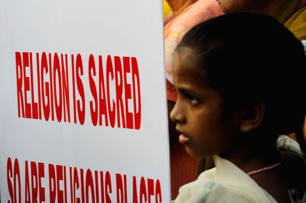 Christians stage a demonstration against attack on places pf worship in Mumbai, on March 27, 2015.