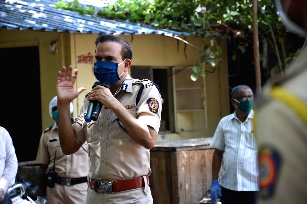 Mumbai Comissioner of Police Param Bir Singh interacts with police personal to motivate them at the JJ Marg Police Station after 28 cops from the police station tested COVID-19 positive in Mumbai ... - Param Bir Singh
