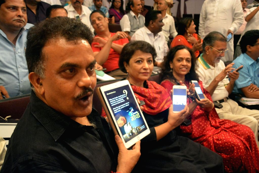 "Mumbai Congress chief Sanjay Nirupam during a protest against the ""unfair"" fees being levied by banks at Ravindra Natya Mandir, in Mumbai, on July 4, 2017."