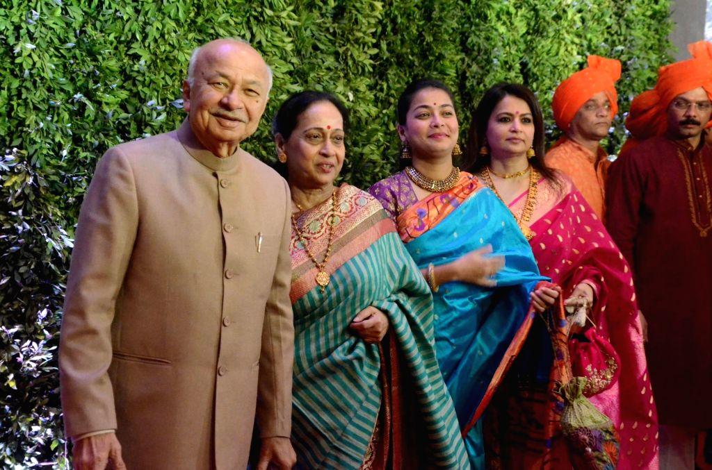 Mumbai: Congress leader Sushilkumar Shinde with his wife Ujwala Shinde and daughter Praniti Shinde at Maharashtra Navnirman Sena (MNS) chief Raj Thackeray's son Amit Thackeray's wedding reception in Mumbai, on Jan 27, 2019. (Photo: IANS)