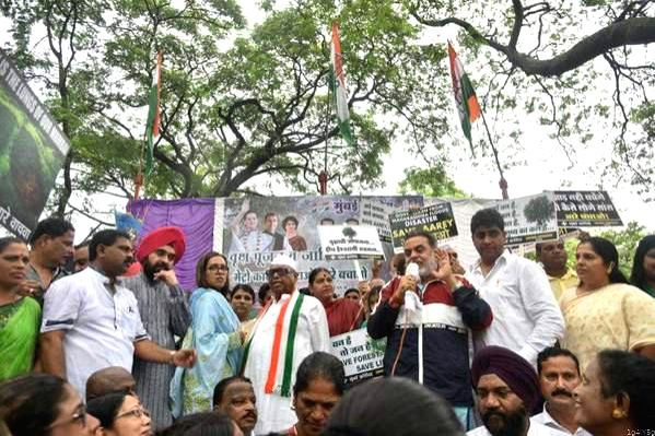 Mumbai Congress President Eknath Gaekwad and former chief Sanjay Nirupam stage a demonstration against the ruling Bharatiya Janata Party- Shiv Sena proposal to hack over 2000 trees from ...