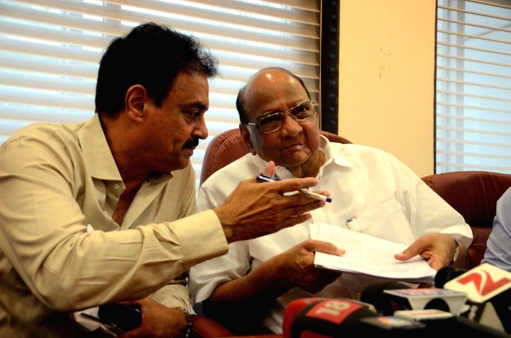Mumbai Cricket Association (MCA) President Sharad Pawar and Vice President Dilip Vengsarkar during a press conference at MCA Headquarter in Mumbai on July 24, 2016. Sharad Pawar will step ...