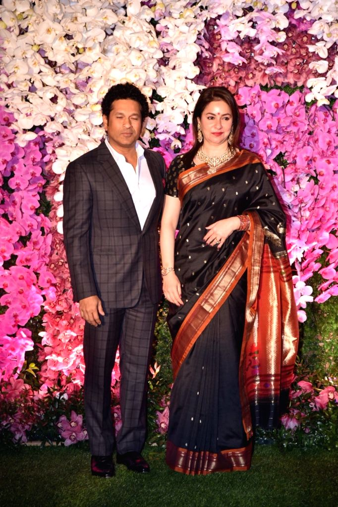 Mumbai: Cricket legend Sachin Tendulkar along with his wife Anjali Tendulkar at the wedding reception of Akash Ambani and Shloka Mehta in Mumbai on March 10, 2019. (Photo: IANS) - Sachin Tendulkar, Akash Ambani and Shloka Mehta