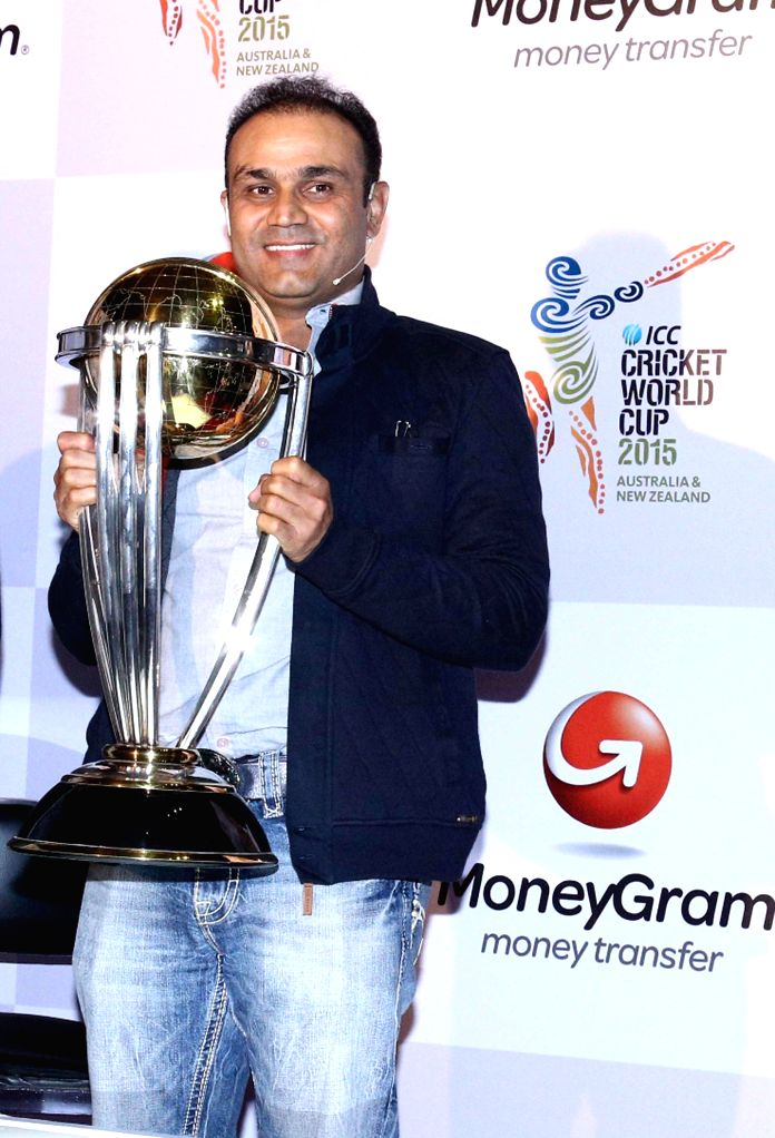 Cricketer Virender Sehwag with the ICC World Cup during a programme in Mumbai, on Dec 2, 2014.