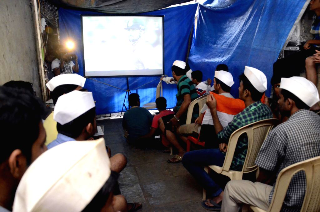 Dabbewallas (one who carries the box) watch a ICC World Cup 2015 match between India and Pakistan on a large screen in Mumbai, on Feb 15, 2015.