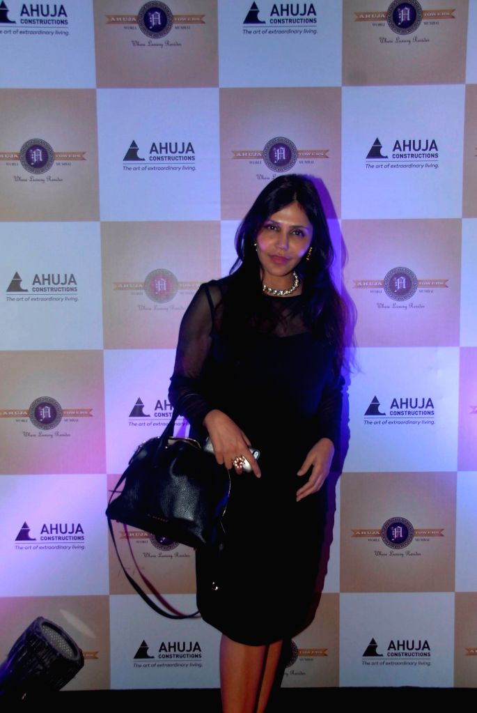 Designer Nisha Jamvwal during a painting exhibition titled The Art of Extraordinary People by Indian Mouth and Foot Painting Artists (IMFPA) hosted by Gautam Ahuja, MD, Ahuja Constructions in
