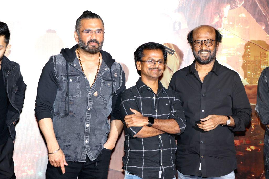 "Mumbai: Director A.R. Murugadoss and actors Rajinikanth and Sunil Shetty at the trailer launch of their upcoming film ""Darbar"" in Mumbai on Dec 16, 2019. (Photo: IANS) - Rajinikanth and Sunil Shetty"