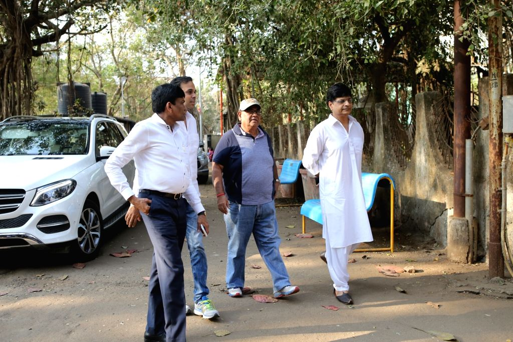 Mumbai: Director Satish Kaushik arrives at the residence of Raj Kumar Barjatya who died on in Mumbai on Feb 21, 2019. (Photo: IANS) - Kumar Barjatya
