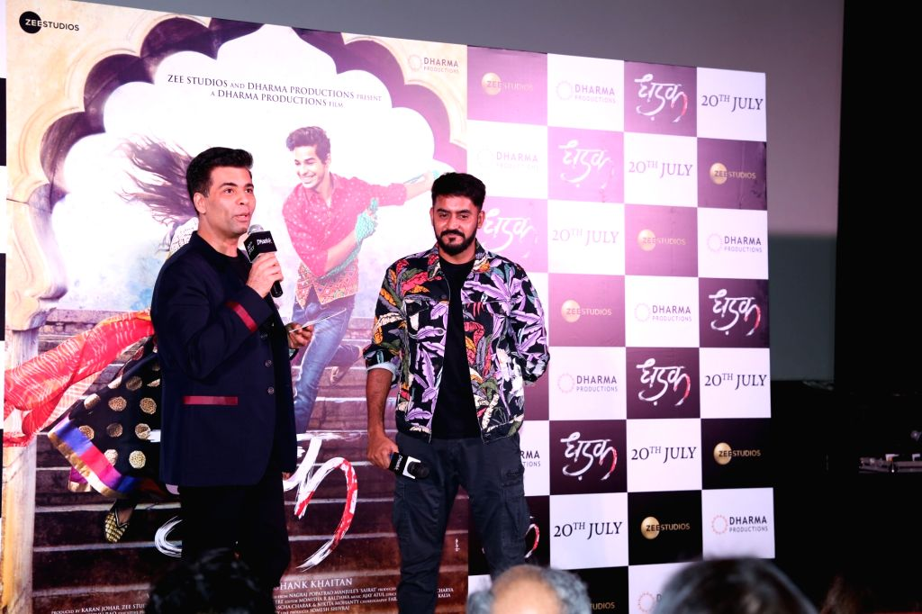 ":Mumbai: Director Shashank Khaitan and producer Karan Johar at the trailer launch of their upcoming film ""Dhadak""  in Mumbai on June 11, 2018. (Photo: IANS)."